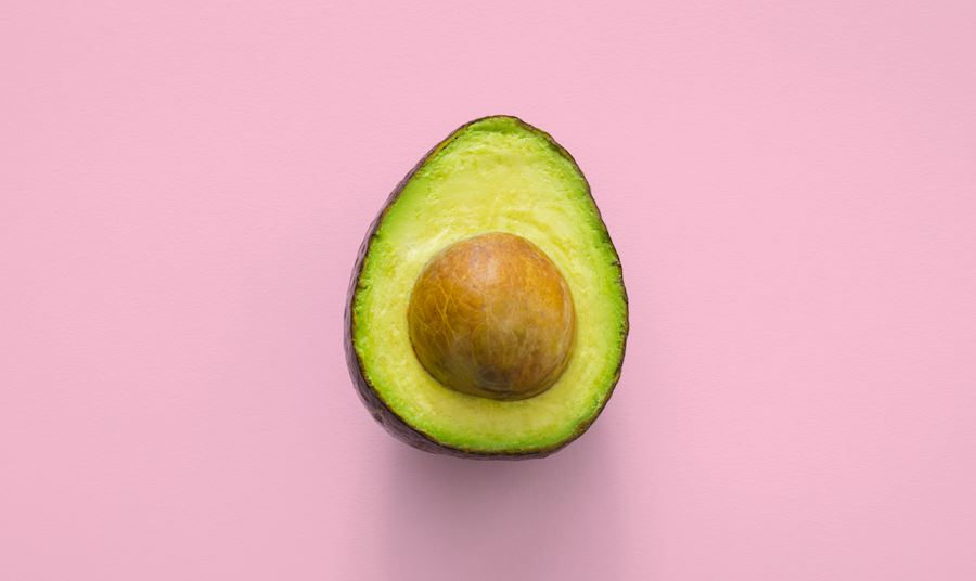 Avocado against a pink background