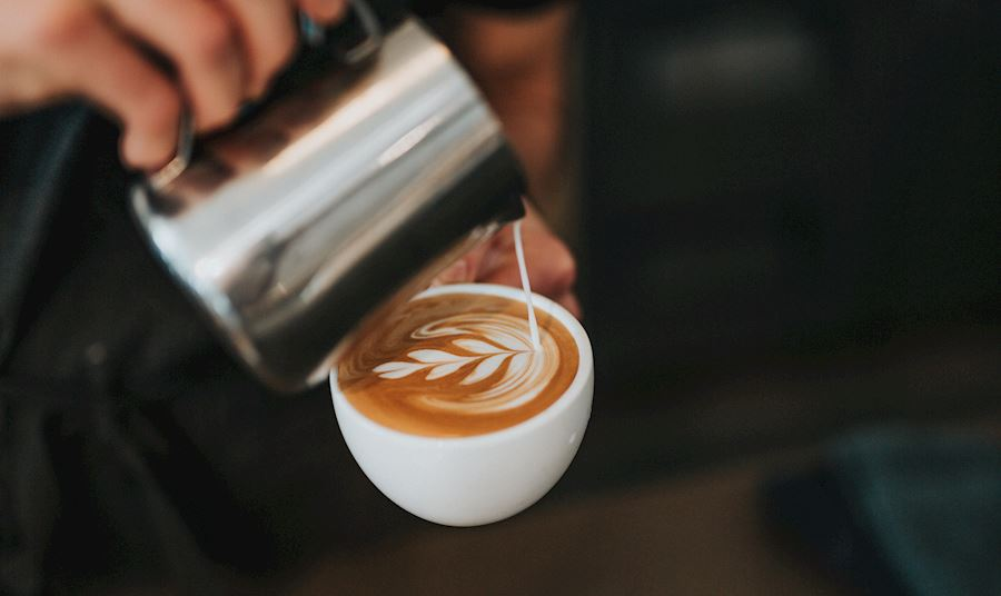 Man pouring coffee into a cup